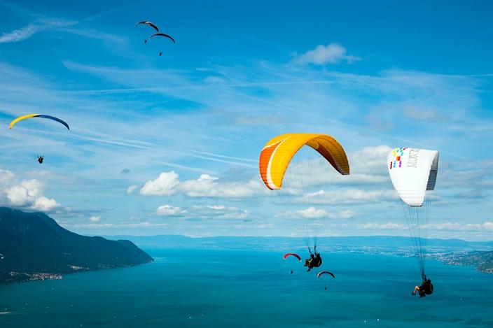 Colorful paragliding above Lake Geneva in Switzerland   Sport
