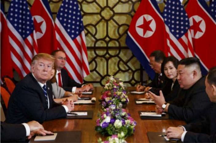金正恩與特朗普。AP圖片