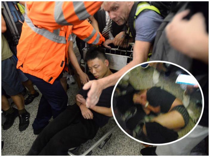 圖:內地男子被綁在手推車上。