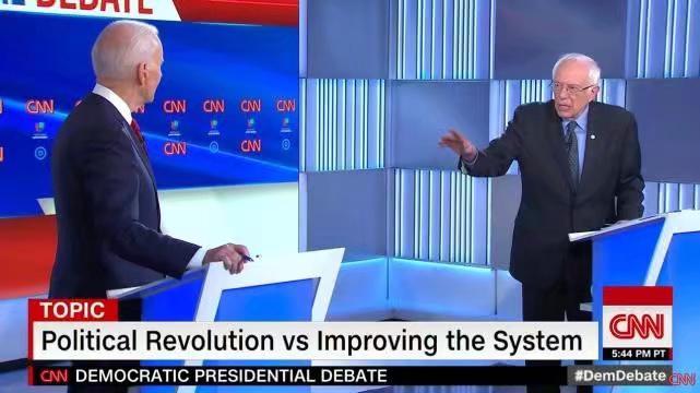 拜登(左)和桑德斯(右)在辯論中。CNN影片截圖