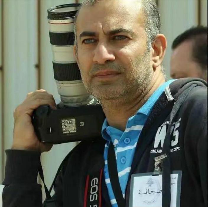 新华社摄影师贾维希。