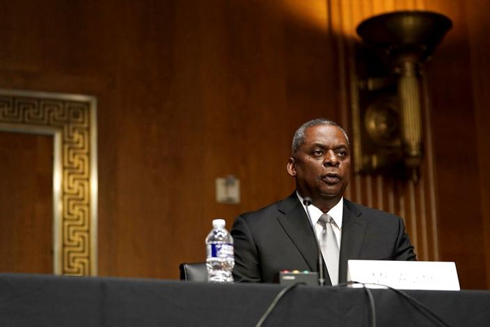 美國國防部長候選人奧斯汀在國會作證。(AP圖片)