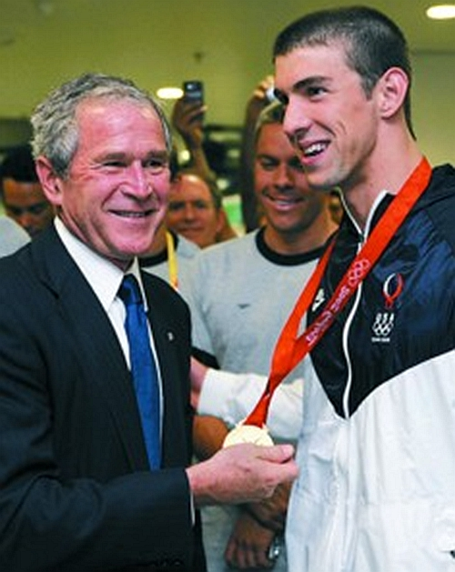 Bush met with Phoebe in the backcourt and touched his gold medal and didn't let go.