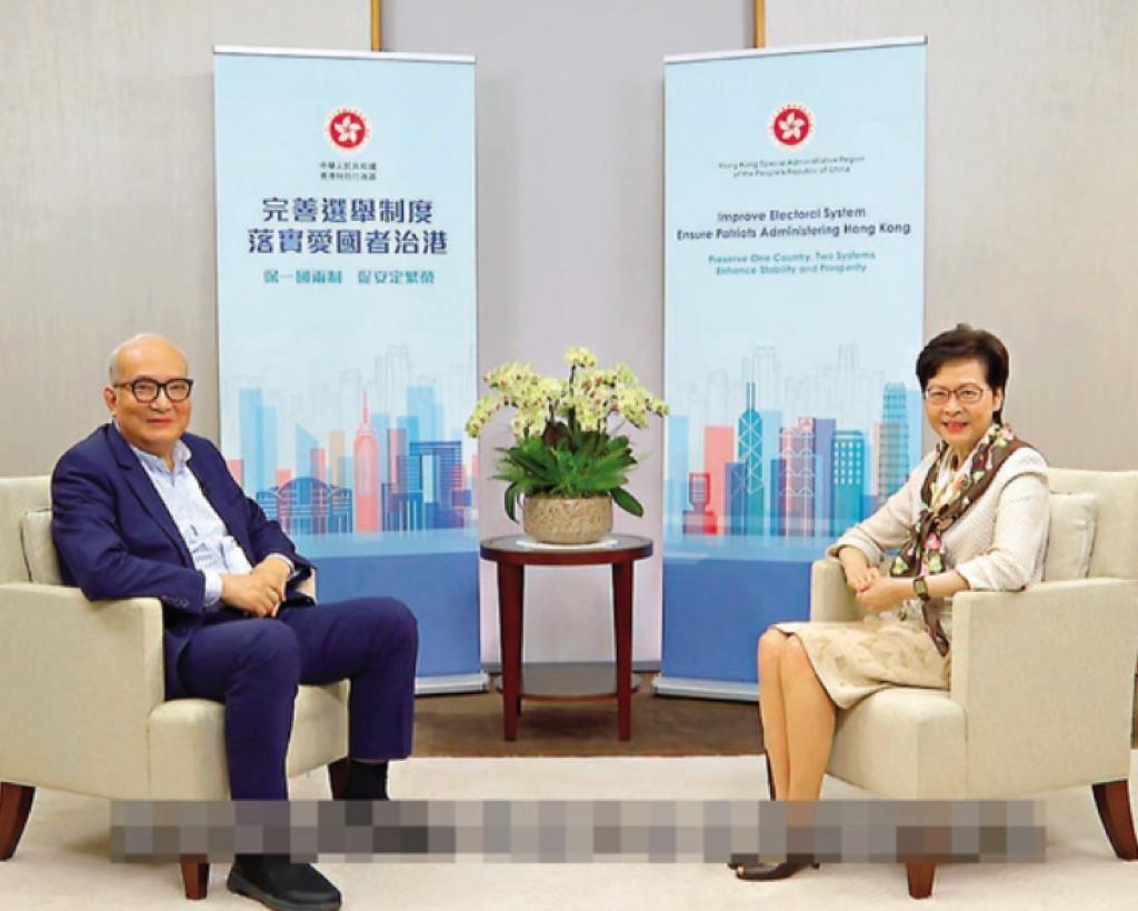 林鄭訪問社會服務發展研究中心主席邱浩波。