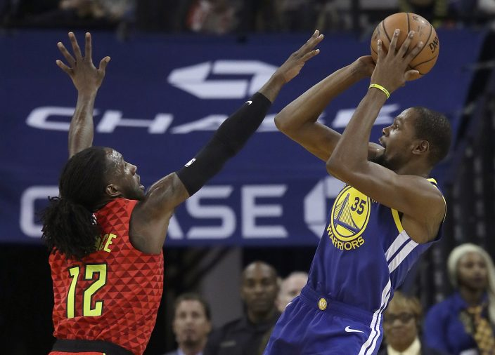 37c2cc049799 Golden State Warriors forward Kevin Durant (35) shoots against Atlanta  Hawks forward Taurean Prince (12) during the first half of an NBA  basketball game in ...