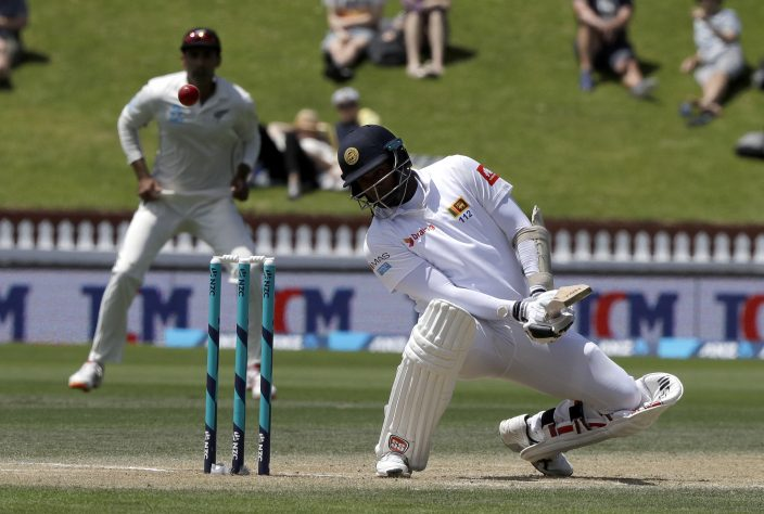 19d8e4ab Sri Lanka's Angelo Mathews ducks under a bouncer while batting during play  on day four of the first cricket test between New Zealand and Sri Lanka in  ...