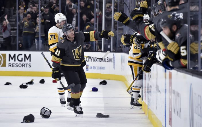 Vegas Golden Knights center Jonathan Marchessault (81) celebrates with  teammates after scoring his third goal of the night against the Pittsburgh  Penguin 871d88466