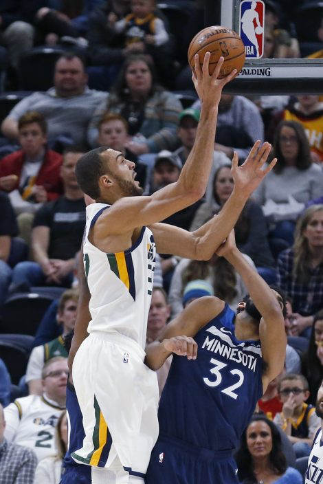 ce32ee03 Utah Jazz center Rudy Gobert (27) shoots as Minnesota Timberwolves center  Karl-Anthony Towns (32) defends during the first half of an NBA basketball  game ...
