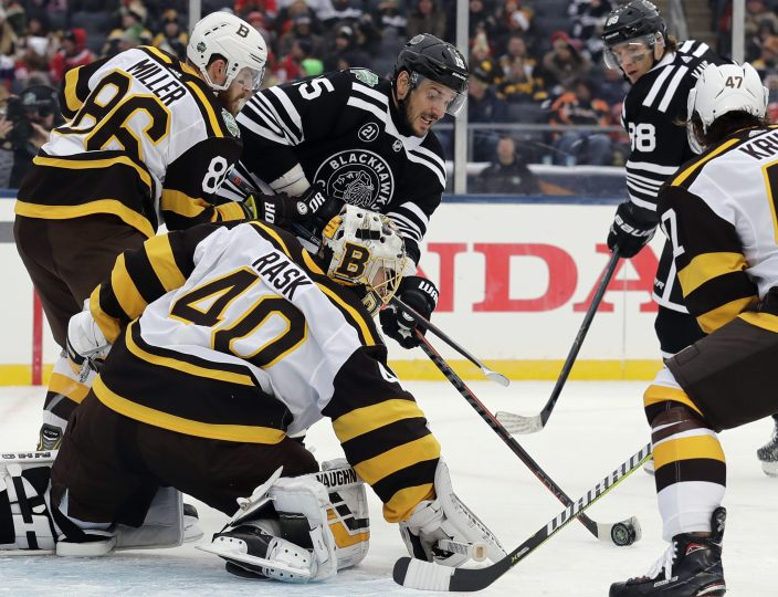 ... (15) shoots against Boston Bruins goalie Tuukka Rask (40) and  defenseman Kevan Miller (86) in the second period of the NHL Winter Classic  hockey game at ... 1ac69955e