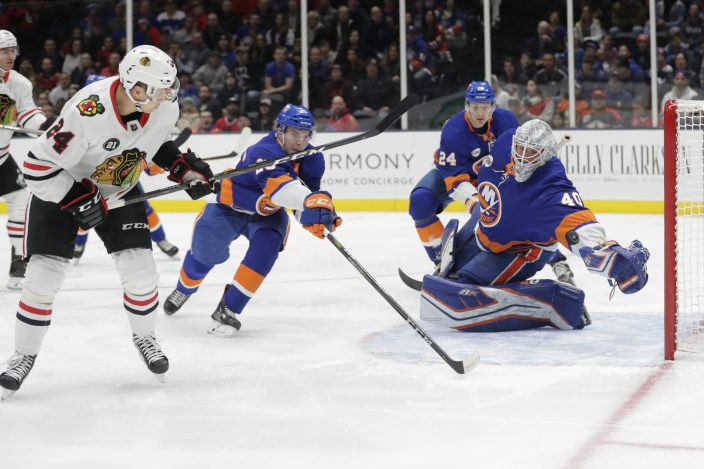 Chicago Blackhawks  Dominik Kahun (24) shoots the puck past New York  Islanders goaltender Robin Lehner (40) during the first period of an NHL  hockey game ... a19905ab8