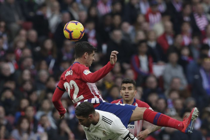 Atletico Madrid s Alvaro Morata jumps for the ball during a Spanish La Liga  soccer match between Atletico Madrid and Real Madrid at the Metropolitano  ... 7662bfea2