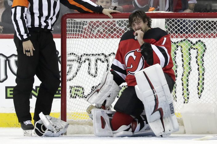 8b1d9e253 New Jersey Devils goaltender Keith Kinkaid (1) takes a moment after taking  a stick to the mask during the second period of an NHL hockey game against  the ...