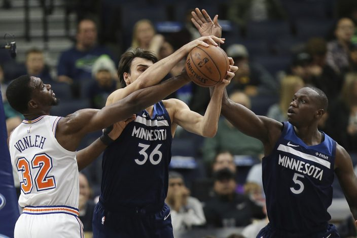 0169ed38a8ba9a Minnesota Timberwolves  Dario Saric (36) and Minnesota Gorgui Dieng (5) go  for a rebound ball against New York Knicks  Noah Vonleh (32) in the first  half of ...