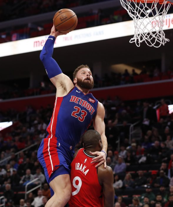 123cb6deb Detroit Pistons forward Blake Griffin (23) goes for a dunk over Toronto  Raptors center Serge Ibaka (9) during the first half of an NBA basketball  game