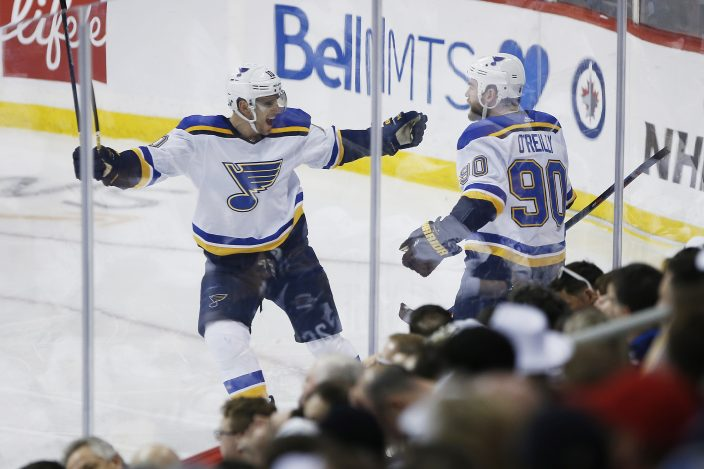 11c68e858a7 St. Louis Blues centre Ryan O'Reilly (90) celebrates his goal against the  Winnipeg Jets with Brayden Schenn (10) during the third period of Game 2 of  an NHL ...
