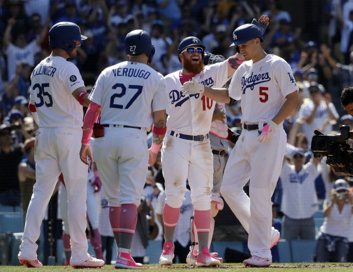 52140bc97 Los Angeles Dodgers  Corey Seager (5) is met at home plate by teammates Cody  Bellinger (35)